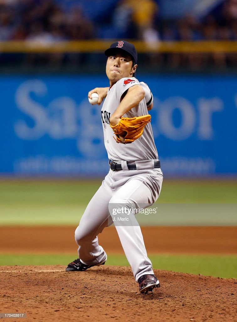 Pitcher <a gi-track='captionPersonalityLinkClicked' href=/galleries/search?phrase=Koji+Uehara&family=editorial&specificpeople=801278 ng-click='$event.stopPropagation()'>Koji Uehara</a> #19 of the Boston Red Sox gets the last out of the eighth inning against the Tampa Bay Rays during the game at Tropicana Field on June 12, 2013 in St. Petersburg, Florida.