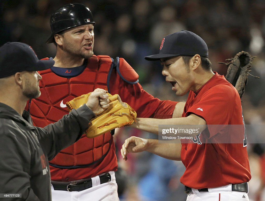 Pitcher <a gi-track='captionPersonalityLinkClicked' href=/galleries/search?phrase=Koji+Uehara&family=editorial&specificpeople=801278 ng-click='$event.stopPropagation()'>Koji Uehara</a> #19 of the Boston Red Sox is congratulated by catchers <a gi-track='captionPersonalityLinkClicked' href=/galleries/search?phrase=David+Ross+-+Baseball+Player&family=editorial&specificpeople=210843 ng-click='$event.stopPropagation()'>David Ross</a> #3 (L) and <a gi-track='captionPersonalityLinkClicked' href=/galleries/search?phrase=A.J.+Pierzynski&family=editorial&specificpeople=204486 ng-click='$event.stopPropagation()'>A.J. Pierzynski</a> #40 after retiring the Tampa Bay Rays in the ninth inning at Fenway Park on May 30, 2014 in Boston, Massachusetts.