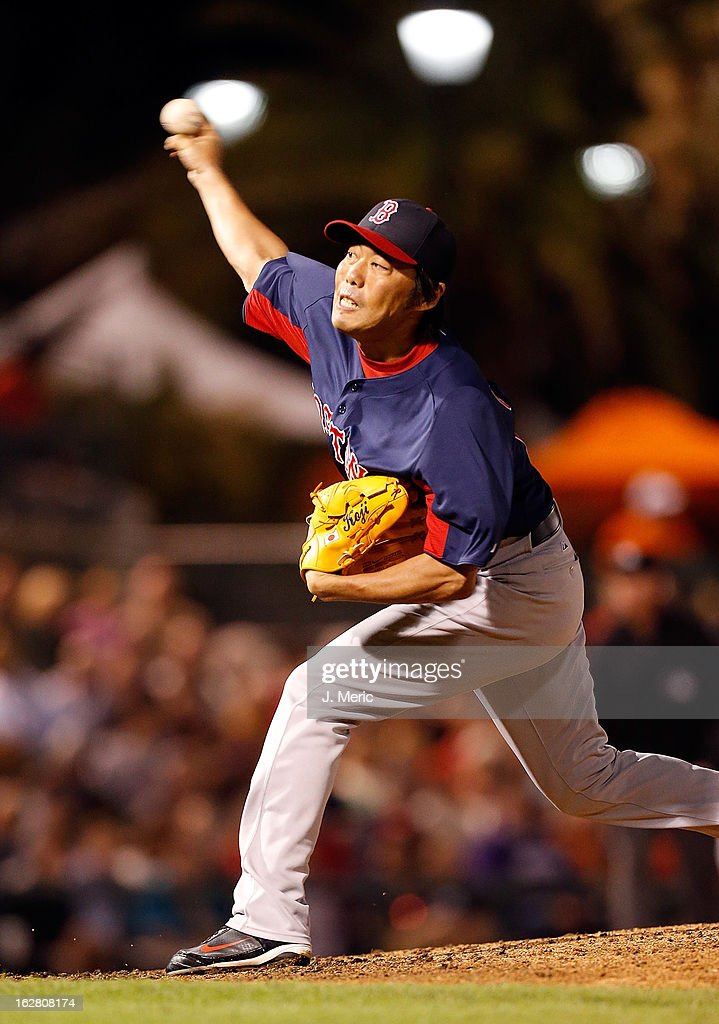Pitcher Koji Uehara #19 of the Boston Red Sox pitches against the Baltimore Orioles during a Grapefruit League Spring Training Game at Ed Smith Stadium on February 27, 2013 in Sarasota, Florida.