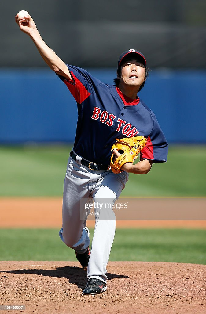 Pitcher <a gi-track='captionPersonalityLinkClicked' href=/galleries/search?phrase=Koji+Uehara&family=editorial&specificpeople=801278 ng-click='$event.stopPropagation()'>Koji Uehara</a> #19 of the Boston Red Sox pitches against the Tampa Bay Rays during a Grapefruit League Spring Training Game at the Charlotte Sports Complex on March 10, 2013 in Port Charlotte, Florida.