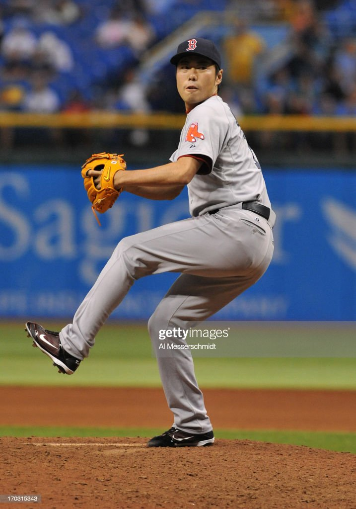 Pitcher <a gi-track='captionPersonalityLinkClicked' href=/galleries/search?phrase=Koji+Uehara&family=editorial&specificpeople=801278 ng-click='$event.stopPropagation()'>Koji Uehara</a> #19 of the Boston Red Sox pitches in relief against the Tampa Bay Rays June 10, 2013 at Tropicana Field in St. Petersburg, Florida.