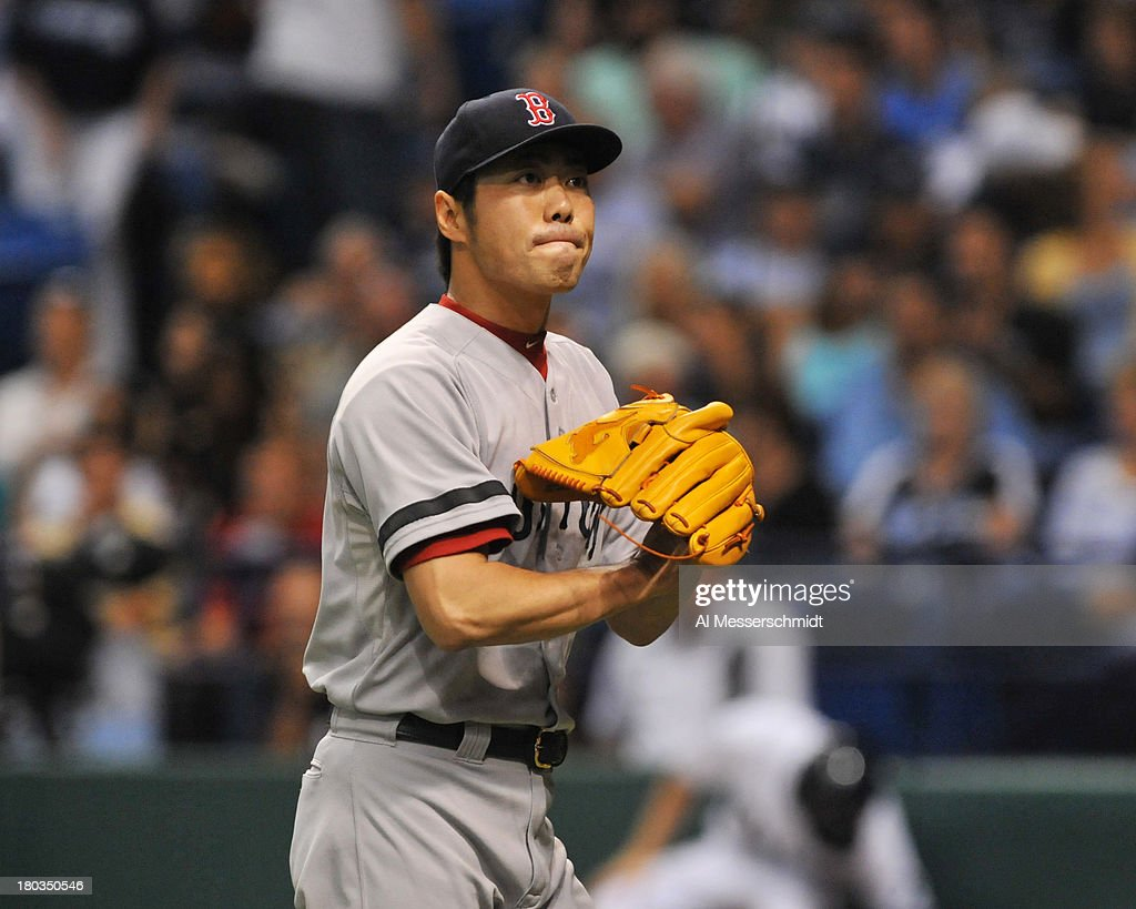 Pitcher Koji Uehara #19 of the Boston Red Sox pumps his fist into his mitt after throwing in relief in the ninth inning against the Tampa Bay Rays September 11, 2013 at Tropicana Field in St. Petersburg, Florida. Boston won 7 - 3.