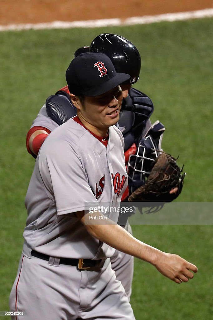 Pitcher Koji Uehara #19 of the Boston Red Sox shakes hands with catcher Christian Vazquez #7 after retiring the side in the eighth inning against the Baltimore Orioles at Oriole Park at Camden Yards on May 31, 2016 in Baltimore, Maryland.
