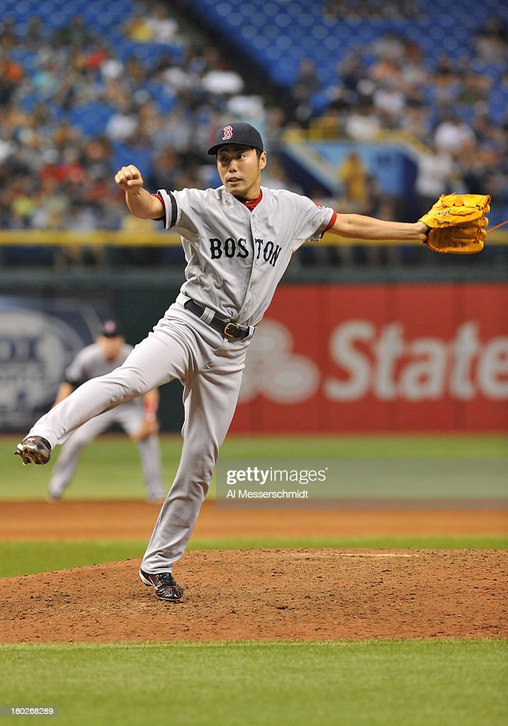 Pitcher <a gi-track='captionPersonalityLinkClicked' href=/galleries/search?phrase=Koji+Uehara&family=editorial&specificpeople=801278 ng-click='$event.stopPropagation()'>Koji Uehara</a> #19 of the Boston Red Sox throws in relief in the 9th inning against the Tampa Bay Rays September 10, 2013 at Tropicana Field in St. Petersburg, Florida. Boston won 2 - 0.