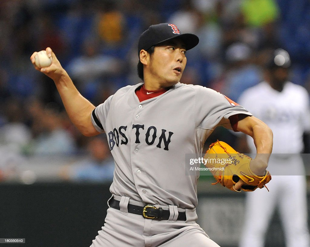 Pitcher <a gi-track='captionPersonalityLinkClicked' href=/galleries/search?phrase=Koji+Uehara&family=editorial&specificpeople=801278 ng-click='$event.stopPropagation()'>Koji Uehara</a> #19 of the Boston Red Sox throws in relief in the ninth inning against the Tampa Bay Rays September 11, 2013 at Tropicana Field in St. Petersburg, Florida.