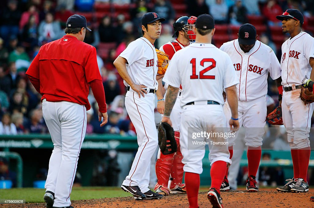 Pitcher <a gi-track='captionPersonalityLinkClicked' href=/galleries/search?phrase=Koji+Uehara&family=editorial&specificpeople=801278 ng-click='$event.stopPropagation()'>Koji Uehara</a> #19 of the Boston Red Sox waits on the mound for a visit from Manager <a gi-track='captionPersonalityLinkClicked' href=/galleries/search?phrase=John+Farrell+-+Baseball+Manager&family=editorial&specificpeople=10307520 ng-click='$event.stopPropagation()'>John Farrell</a> #53 of the Boston Red Sox during the ninth inning of the game against the Minnesota Twins at Fenway Park on June 4, 2015 in Boston, Massachusetts.