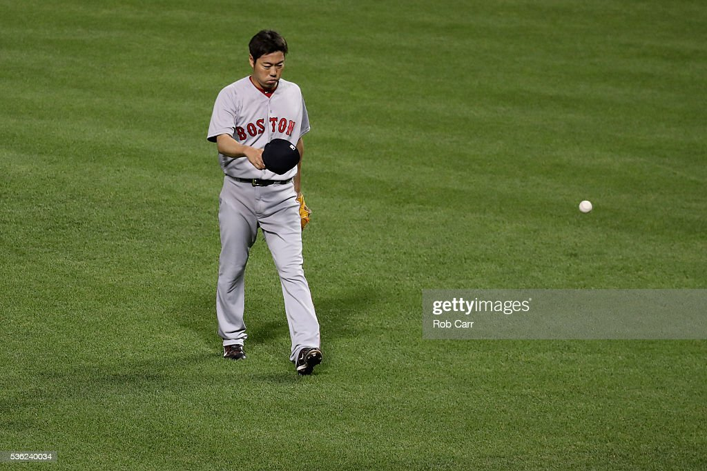 Pitcher Koji Uehara #19 of the Boston Red Sox walks off the field after retiring the side in the eighth inning against the Baltimore Orioles at Oriole Park at Camden Yards on May 31, 2016 in Baltimore, Maryland.