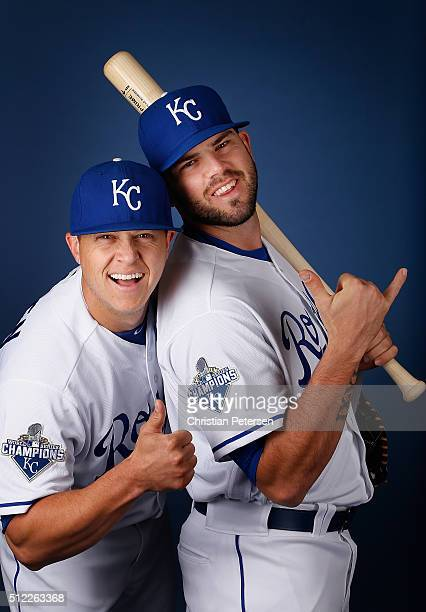 Pitcher Kris Medlen and Mike Moustakas of the Kansas City Royals poses for a portrait during spring training photo day at Surprise Stadium on...