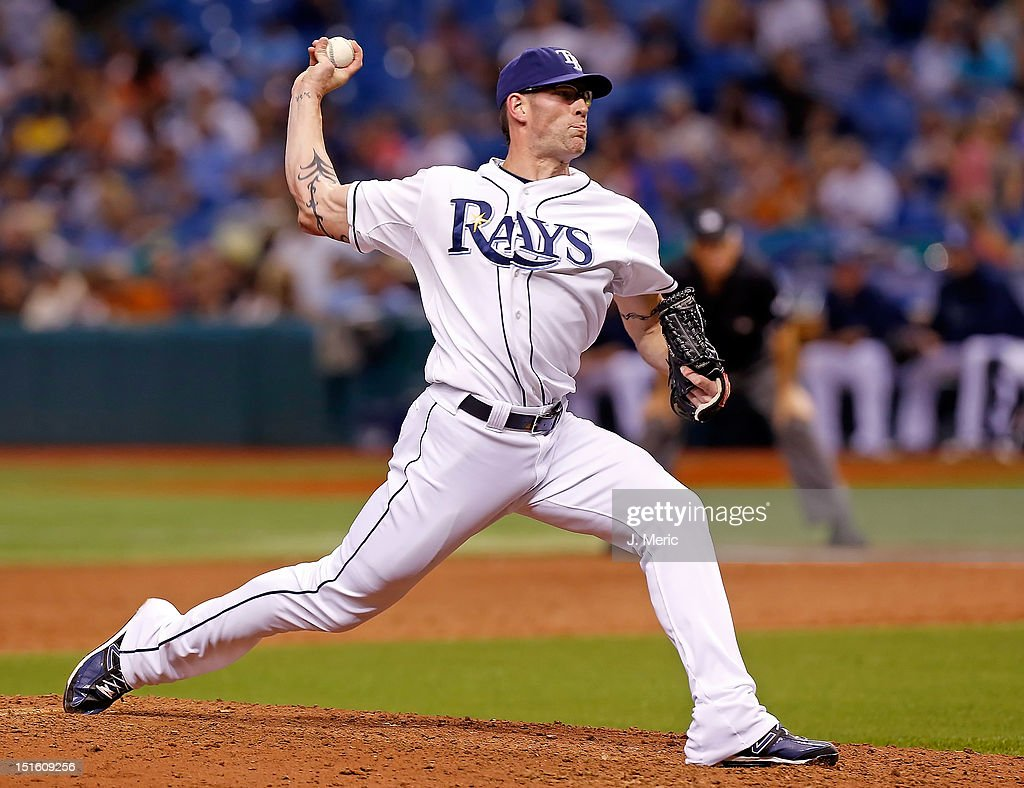 Pitcher <a gi-track='captionPersonalityLinkClicked' href=/galleries/search?phrase=Kyle+Farnsworth&family=editorial&specificpeople=162760 ng-click='$event.stopPropagation()'>Kyle Farnsworth</a> #43 of the Tampa Bay Rays pitches against the Texas Rangers during the game at Tropicana Field on September 8, 2012 in St. Petersburg, Florida.