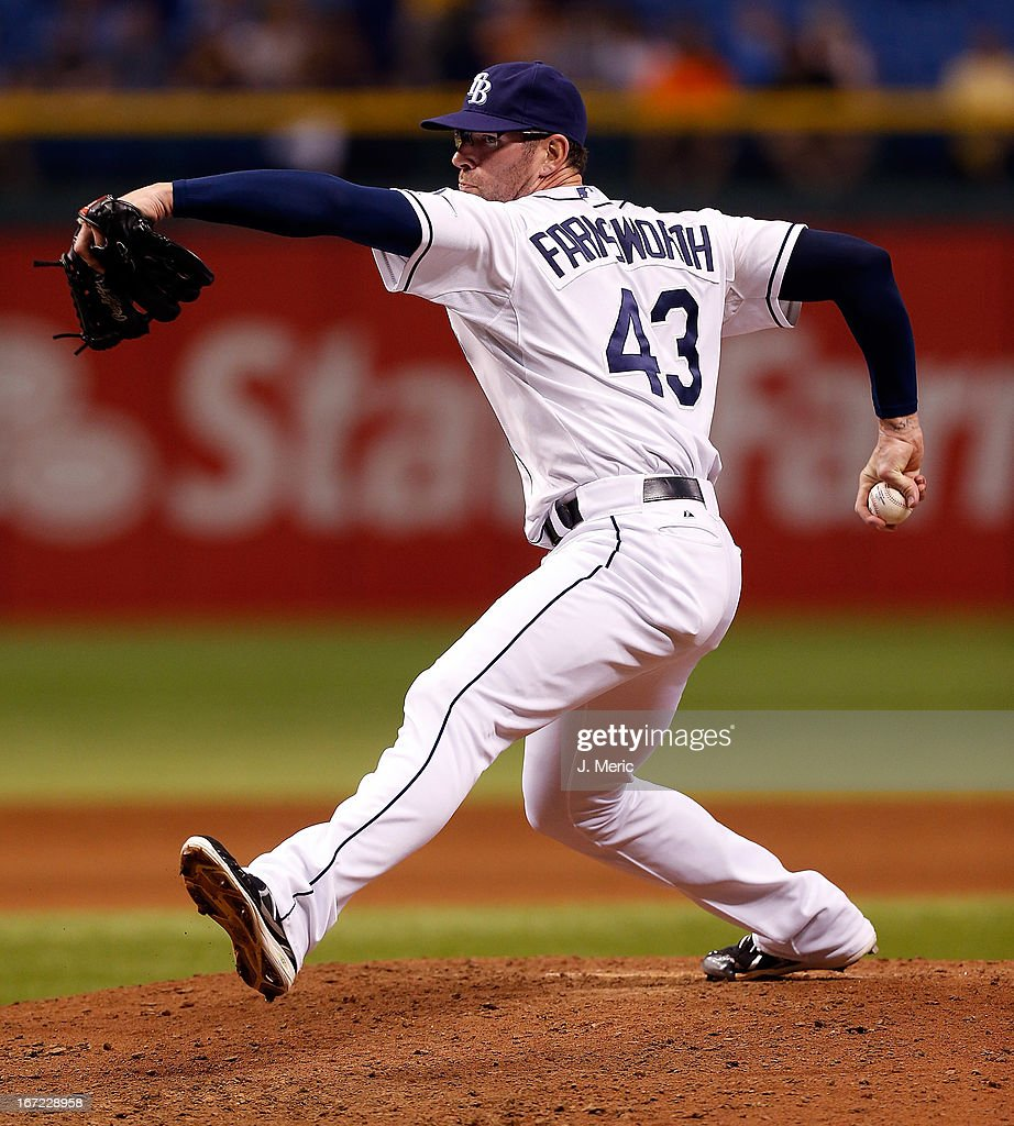 Pitcher <a gi-track='captionPersonalityLinkClicked' href=/galleries/search?phrase=Kyle+Farnsworth&family=editorial&specificpeople=162760 ng-click='$event.stopPropagation()'>Kyle Farnsworth</a> #43 of the Tampa Bay Rays pitches the ninth inning against the New York Yankees during the game at Tropicana Field on April 22, 2013 in St. Petersburg, Florida.