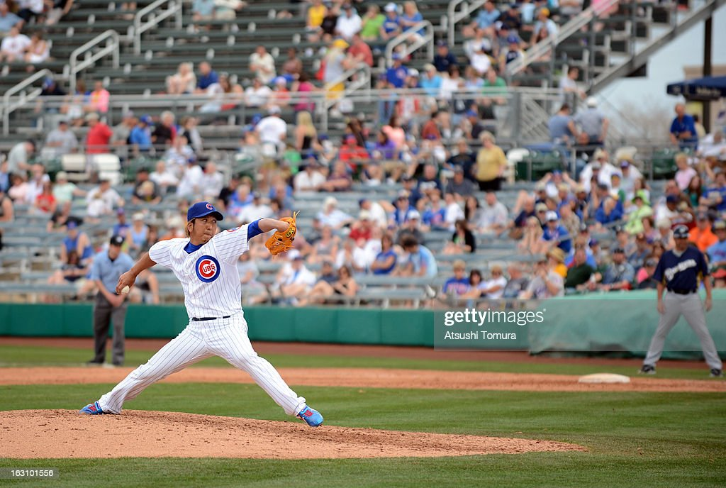Pitcher <a gi-track='captionPersonalityLinkClicked' href=/galleries/search?phrase=Kyuji+Fujikawa&family=editorial&specificpeople=807185 ng-click='$event.stopPropagation()'>Kyuji Fujikawa</a> #11 of Chicago Cubs throws during the spring training match against Milwaukee Brewers on March 3, 2013 in Mesa, Arizona.
