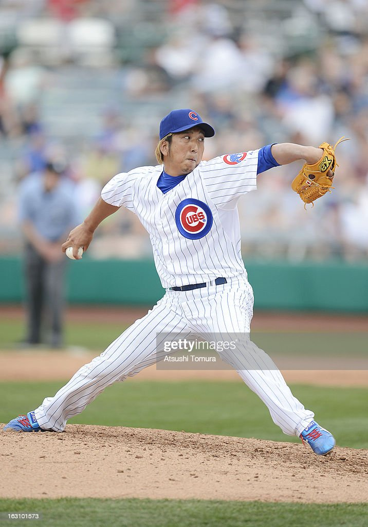 Pitcher Kyuji Fujikawa #11 of Chicago Cubs throws during the spring training match against Milwaukee Brewers on March 3, 2013 in Mesa, Arizona.