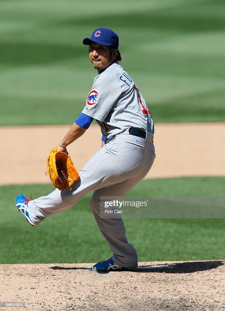 Pitcher Kyuji Fujikawa #11 of the Chicago Cubs throws to a Washington Nationals batter at Nationals Park on May 12, 2013 in Washington, DC.