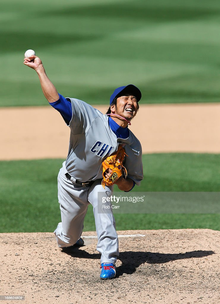 Pitcher <a gi-track='captionPersonalityLinkClicked' href=/galleries/search?phrase=Kyuji+Fujikawa&family=editorial&specificpeople=807185 ng-click='$event.stopPropagation()'>Kyuji Fujikawa</a> #11 of the Chicago Cubs throws to a Washington Nationals batter at Nationals Park on May 12, 2013 in Washington, DC.