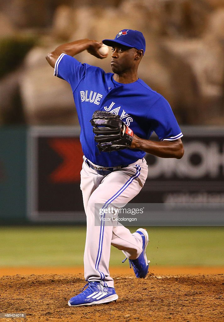 Pitcher LaTroy Hawkins of the Toronto Blue Jays pitches in the seventh inning during the MLB game against the Los Angeles Angels of Anaheim at Angel...