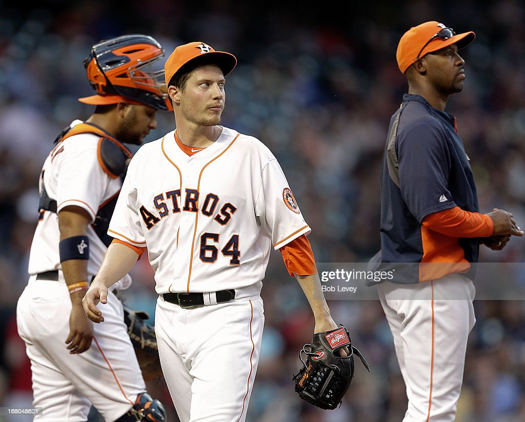 Pitcher <a gi-track='captionPersonalityLinkClicked' href=/galleries/search?phrase=Lucas+Harrell&family=editorial&specificpeople=4946913 ng-click='$event.stopPropagation()'>Lucas Harrell</a> #64 of the Houston Astros leaves the game in the fifth inning as manager Bo Porter #16 of the Houston Astros takes the ball at Minute Maid Park on May 4, 2013 in Houston, Texas.