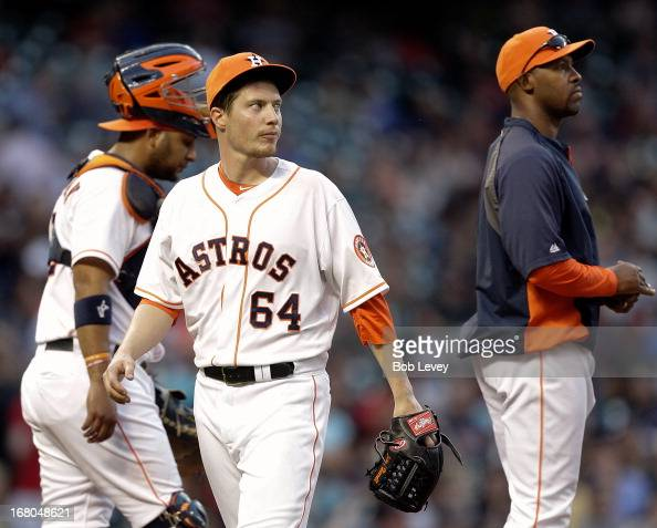 Pitcher Lucas Harrell of the Houston Astros leaves the game in the fifth inning as manager Bo Porter of the Houston Astros takes the ball at Minute...