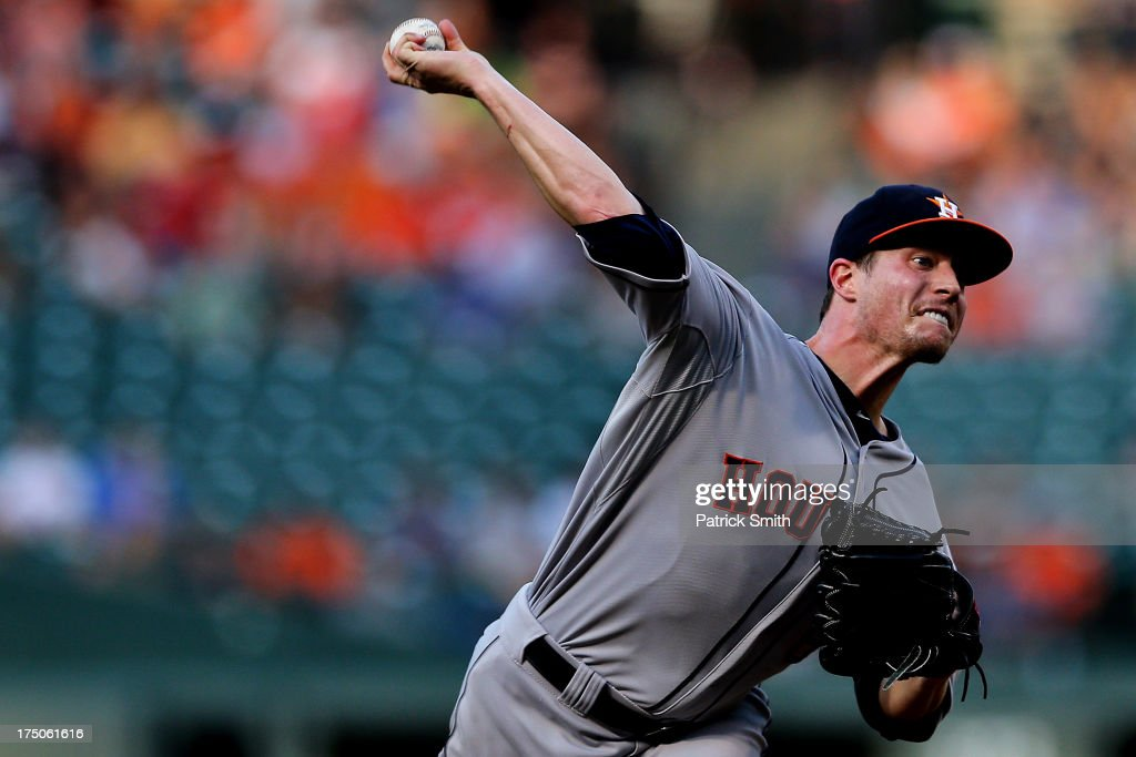 Pitcher <a gi-track='captionPersonalityLinkClicked' href=/galleries/search?phrase=Lucas+Harrell&family=editorial&specificpeople=4946913 ng-click='$event.stopPropagation()'>Lucas Harrell</a> #64 of the Houston Astros works the first inning against the Baltimore Orioles at Oriole Park at Camden Yards on July 30, 2013 in Baltimore, Maryland.