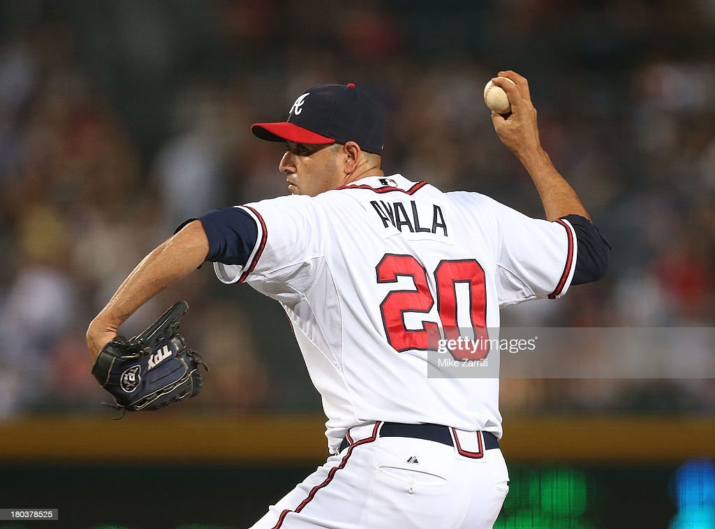 Pitcher <a gi-track='captionPersonalityLinkClicked' href=/galleries/search?phrase=Luis+Ayala&family=editorial&specificpeople=209039 ng-click='$event.stopPropagation()'>Luis Ayala</a> #20 of the Atlanta Braves throws a pitch during the game against the Cleveland Indians at Turner Field on August 27, 2013 in Atlanta, Georgia.
