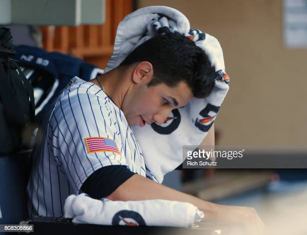 Pitcher Luis Cessa of the New York Yankees wipes his head after pitching the eighth inning against the Toronto Blue Jays during a game at Yankee...