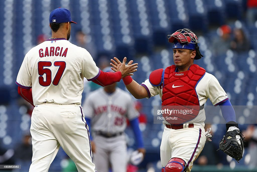 Pitcher Luis Garcia #57 of the Philadelphia Phillies is congratulated by catcher <a gi-track='captionPersonalityLinkClicked' href=/galleries/search?phrase=Carlos+Ruiz+-+Baseball+Player&family=editorial&specificpeople=216605 ng-click='$event.stopPropagation()'>Carlos Ruiz</a> #51 after defeating the New York Mets 3-0 in a MLB game at Citizens Bank Park on October 1, 2015 in Philadelphia, Pennsylvania.