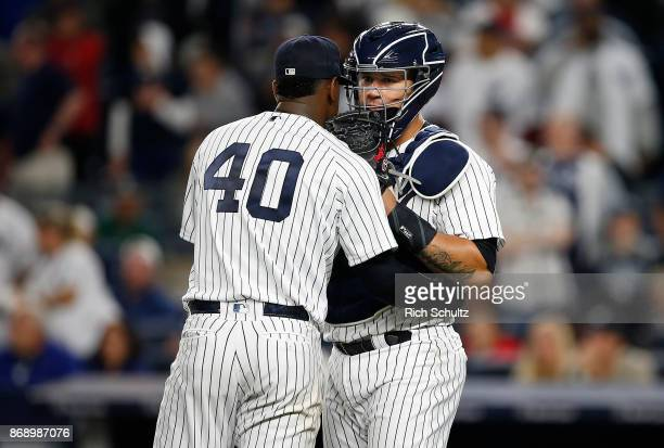 Pitcher Luis Severino and catcher Gary Sanchez of the New York Yankees talk on the mound during a game against the Boston Red Sox at Yankee Stadium...