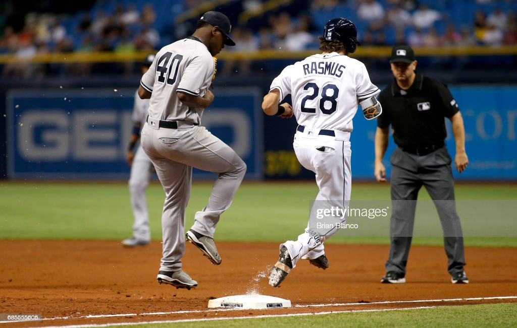 Pitcher Luis Severino #40 of the New York Yankees gets the out at first base on Colby Rasmus #28 of the Tampa Bay Rays to end the first inning of a game on May 19, 2017 at Tropicana Field in St. Petersburg, Florida.