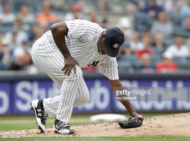 Pitcher Luis Severino of the New York Yankees slips to the mound after following through on a pitch in an MLB baseball game against the Boston Red...