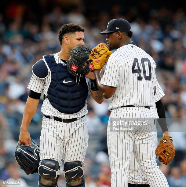 Pitcher Luis Severino of the New York Yankees talks with his catcher Gary Sanchez on the mound in an MLB baseball game against the Detroit Tigers on...