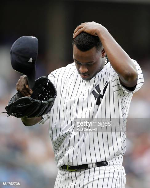 Pitcher Luis Severino of the New York Yankees walks off the mound after being removed from the game in the fifth inning in an MLB baseball game...