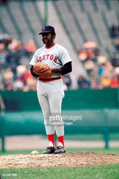 Pitcher Luis Tiant of the Boston Red Sox takes the sign for the next pitch during a game against the Cleveland Indians in 1973 at Municipal Stadium...