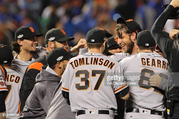 Pitcher Madison Bumgarner of the San Francisco Giants is mobbed by team mates after his nine inning shut out during the San Francisco Giants Vs New...