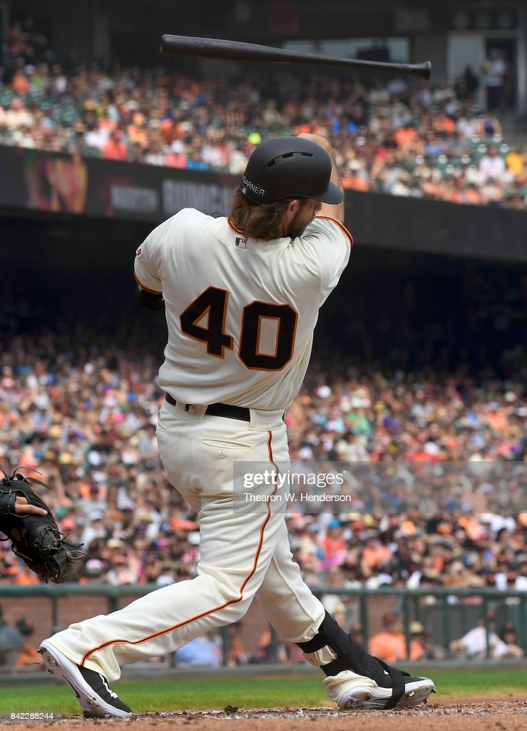 Pitcher Madison Bumgarner #40 of the San Francisco Giants swings and loses control of his bat thowing it into the stands during the bottom of the second inning against the St. Louis Cardinals at AT&T Park on September 3, 2017 in San Francisco, California.