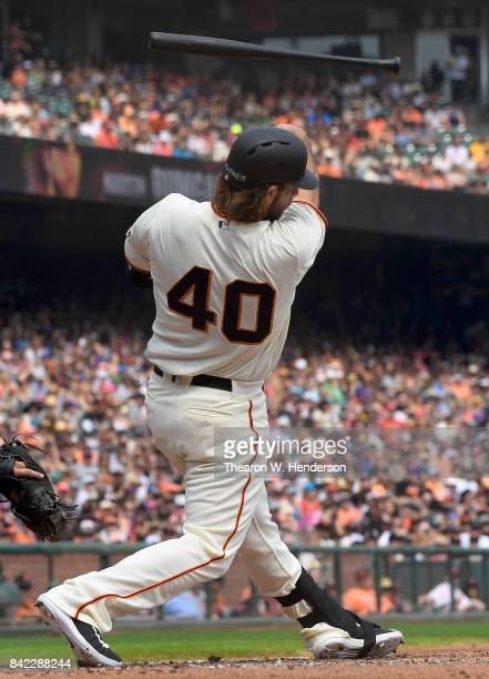 Pitcher Madison Bumgarner of the San Francisco Giants swings and loses control of his bat thowing it into the stands during the bottom of the second...