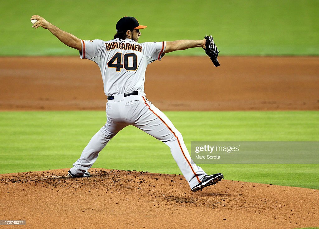 Pitcher <a gi-track='captionPersonalityLinkClicked' href=/galleries/search?phrase=Madison+Bumgarner&family=editorial&specificpeople=5974095 ng-click='$event.stopPropagation()'>Madison Bumgarner</a> #40 of the San Francisco Giants throws against the Miami Marlins at Marlins Park on August 18, 2013 in Miami, Florida.