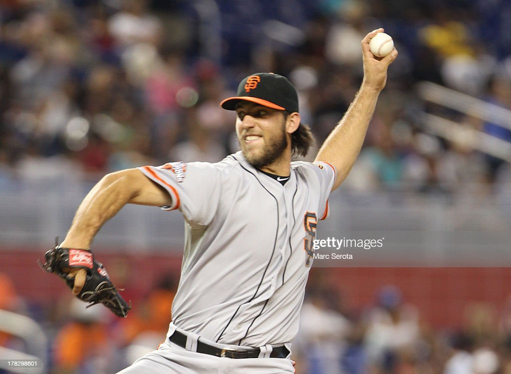 Pitcher <a gi-track='captionPersonalityLinkClicked' href=/galleries/search?phrase=Madison+Bumgarner&family=editorial&specificpeople=5974095 ng-click='$event.stopPropagation()'>Madison Bumgarner</a> #40 of the San Francisco Giants throws against the Miami Marlins at Marlins Park on August 18, 2013 in Miami, Florida. The Marlins defeated the Giants 6-5.