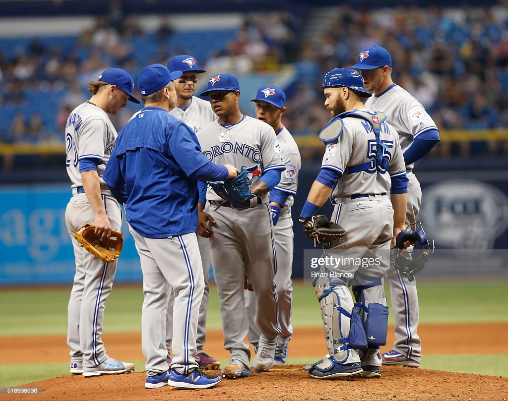 Pitcher Marcus Stroman #6 of the Toronto Blue Jays is taken off the mound by manager John Gibbons #5 during the ninth inning of a game on April 3, 2016 at Tropicana Field in St. Petersburg, Florida.
