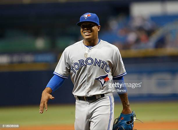 Pitcher Marcus Stroman of the Toronto Blue Jays walks to the dugout after being taken off the mound by manager John Gibbons during the ninth inning...