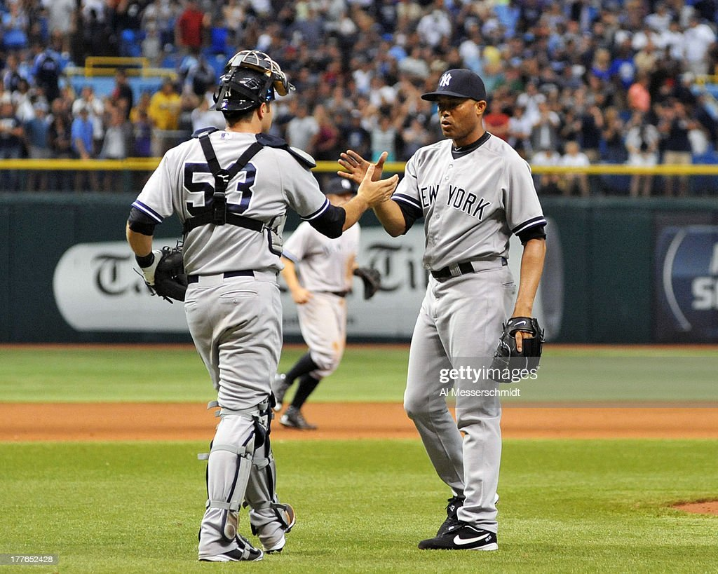 Pitcher Mariano Rivera #42 of the New York Yankees celebrates after throwing in relief against the Tampa Bay Rays August 25, 2013 at Tropicana Field in St. Petersburg, Florida. The Yankees won 3 - 2.