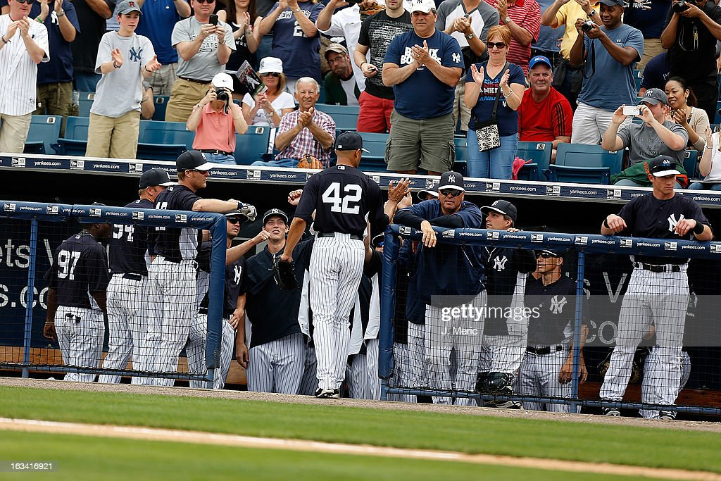 Pitcher Mariano Rivera #42 of the New York Yankees is congratulated after his inning of work against the Atlanta Braves during a Grapefruit League Spring Training Game at George M. Steinbrenner Field on March 9, 2013 in Tampa, Florida.
