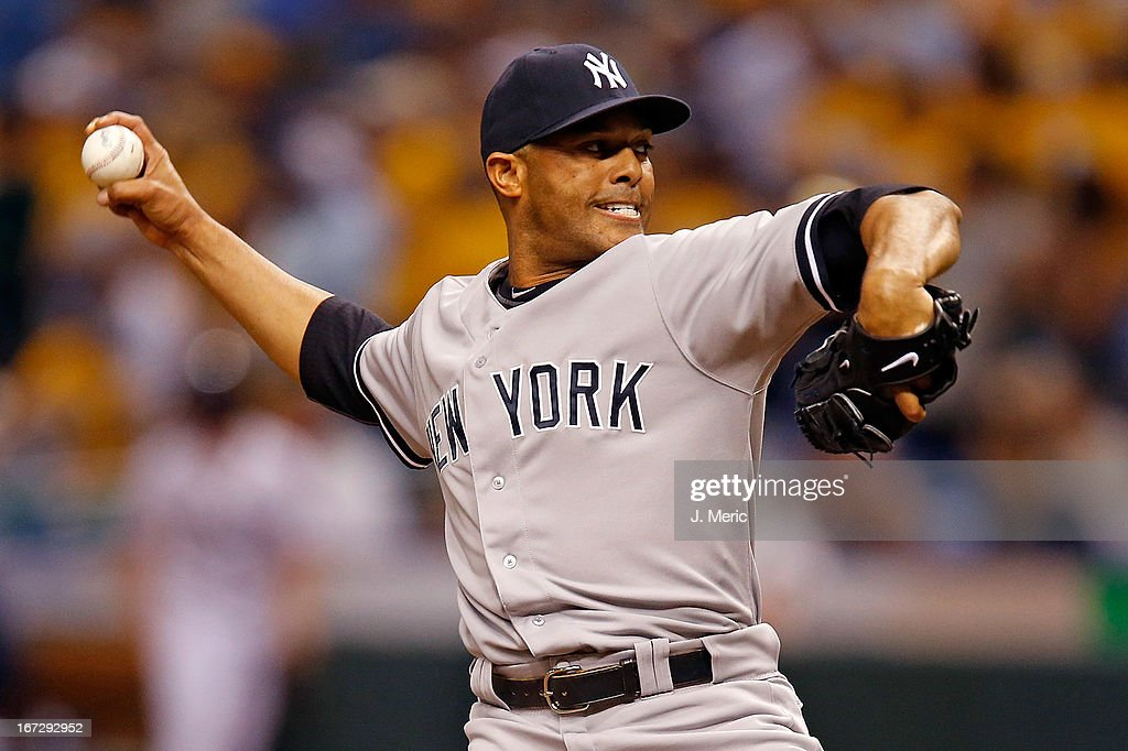 Pitcher <a gi-track='captionPersonalityLinkClicked' href=/galleries/search?phrase=Mariano+Rivera&family=editorial&specificpeople=201607 ng-click='$event.stopPropagation()'>Mariano Rivera</a> #42 of the New York Yankees pitches the ninth inning for the save against the Tampa Bay Rays at Tropicana Field on April 23, 2013 in St. Petersburg, Florida.