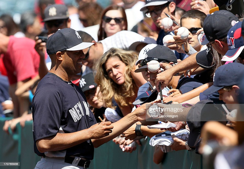 Pitcher <a gi-track='captionPersonalityLinkClicked' href=/galleries/search?phrase=Mariano+Rivera&family=editorial&specificpeople=201607 ng-click='$event.stopPropagation()'>Mariano Rivera</a> #42 of the New York Yankees signs autographs for fans prior to the MLB game against the Los Angeles Angels of Anaheim at Angel Stadium of Anaheim on June 15, 2013 in Anaheim, California. The Angels defeated the Yankees 6-2.