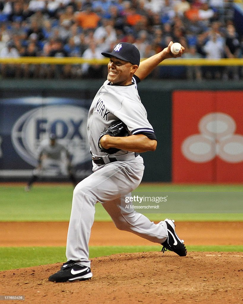 Pitcher <a gi-track='captionPersonalityLinkClicked' href=/galleries/search?phrase=Mariano+Rivera&family=editorial&specificpeople=201607 ng-click='$event.stopPropagation()'>Mariano Rivera</a> #42 of the New York Yankees throws in relief against the Tampa Bay Rays bats August 25, 2013 at Tropicana Field in St. Petersburg, Florida. The Yankees won 3 - 2 in 11 innings.