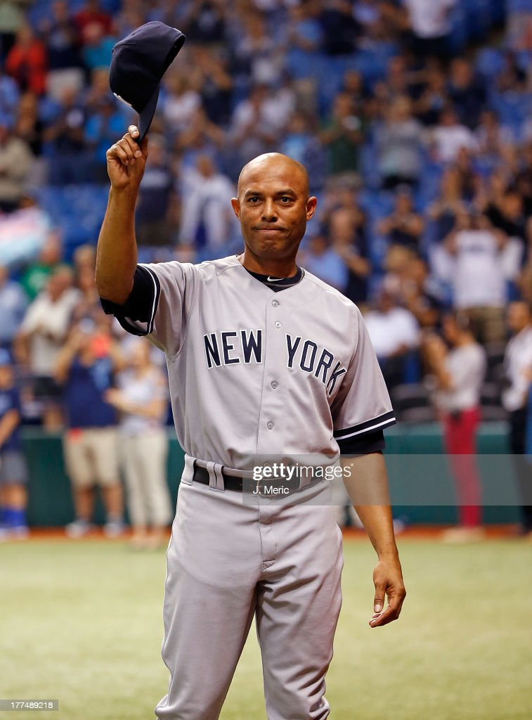 Pitcher <a gi-track='captionPersonalityLinkClicked' href=/galleries/search?phrase=Mariano+Rivera&family=editorial&specificpeople=201607 ng-click='$event.stopPropagation()'>Mariano Rivera</a> #42 of the New York Yankees tips his hat to the crowd as he is recognized just before the start of the game against the Tampa Bay Rays at Tropicana Field on August 23, 2013 in St. Petersburg, Florida.