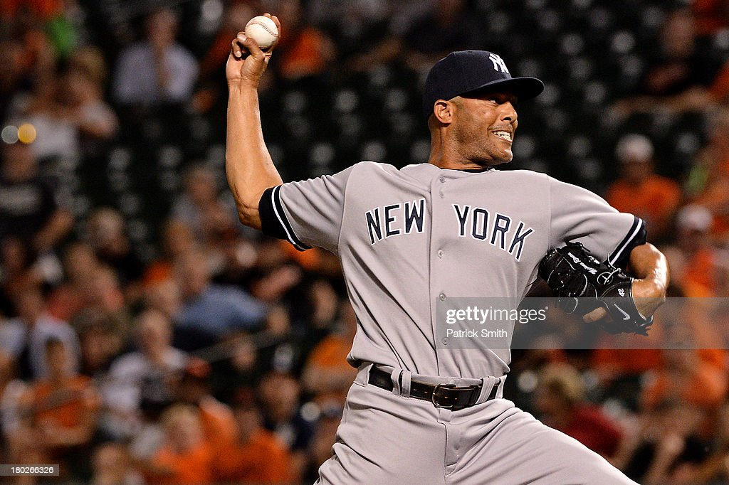 Pitcher <a gi-track='captionPersonalityLinkClicked' href=/galleries/search?phrase=Mariano+Rivera&family=editorial&specificpeople=201607 ng-click='$event.stopPropagation()'>Mariano Rivera</a> #42 of the New York Yankees works the ninth inning against the Baltimore Orioles at Oriole Park at Camden Yards on September 10, 2013 in Baltimore, Maryland.