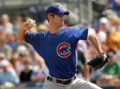 Pitcher Mark Prior of the Chicago Cubs throws a pitch against the Seattle Mariners during Spring Training at Peoria Sports Complex March 5 2007 in...