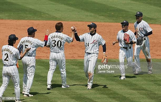 Pitcher Masahide Kobayashi and Yoshinobu Takahashi of Japan celebrate after defeating Canada 91 in the baseball preliminary game on August 20 2004...