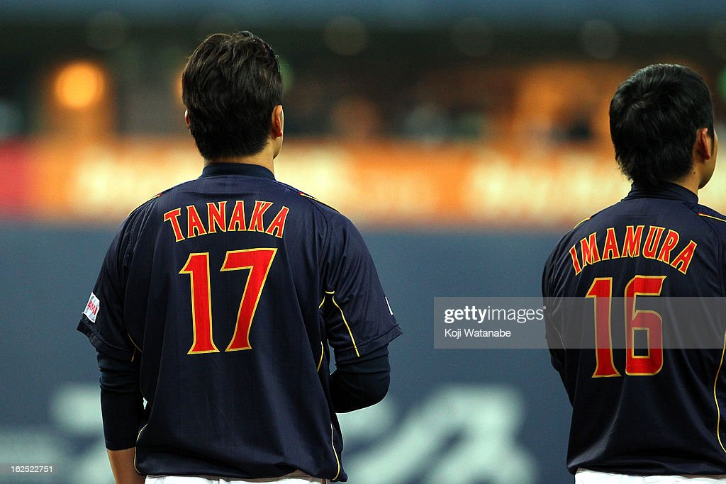 Pitcher Masahiro Tanaka #17 and Pitcher Takeru Imamura #16 of Japan line up for national anthem and the international friendly game between Australia and Japan at Kyocera Dome Osaka on February 24, 2013 in Osaka, Japan.