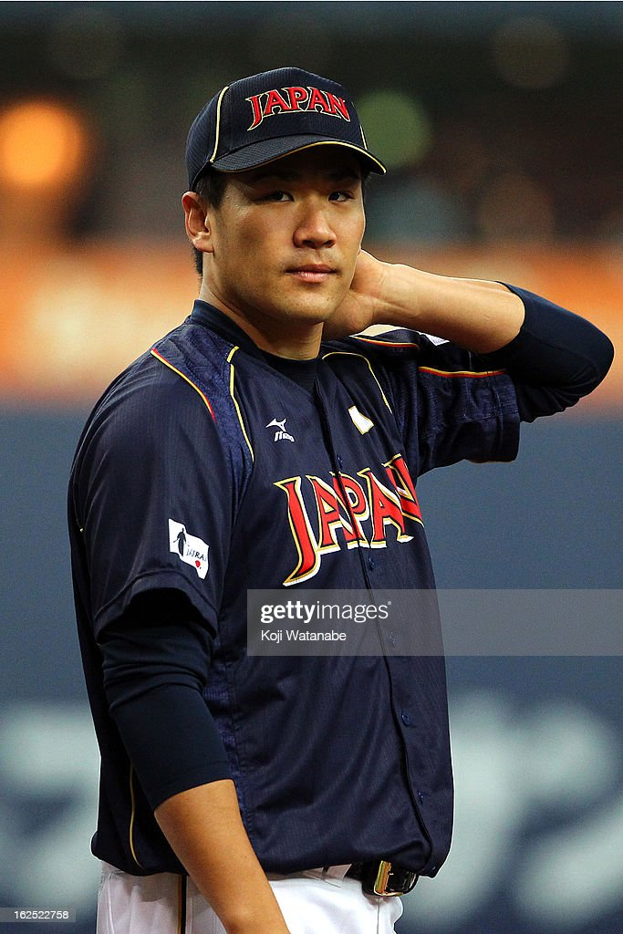 Pitcher <a gi-track='captionPersonalityLinkClicked' href=/galleries/search?phrase=Masahiro+Tanaka&family=editorial&specificpeople=5492836 ng-click='$event.stopPropagation()'>Masahiro Tanaka</a> #17 of Japan looks on the international friendly game between Australia and Japan at Kyocera Dome Osaka on February 24, 2013 in Osaka, Japan.