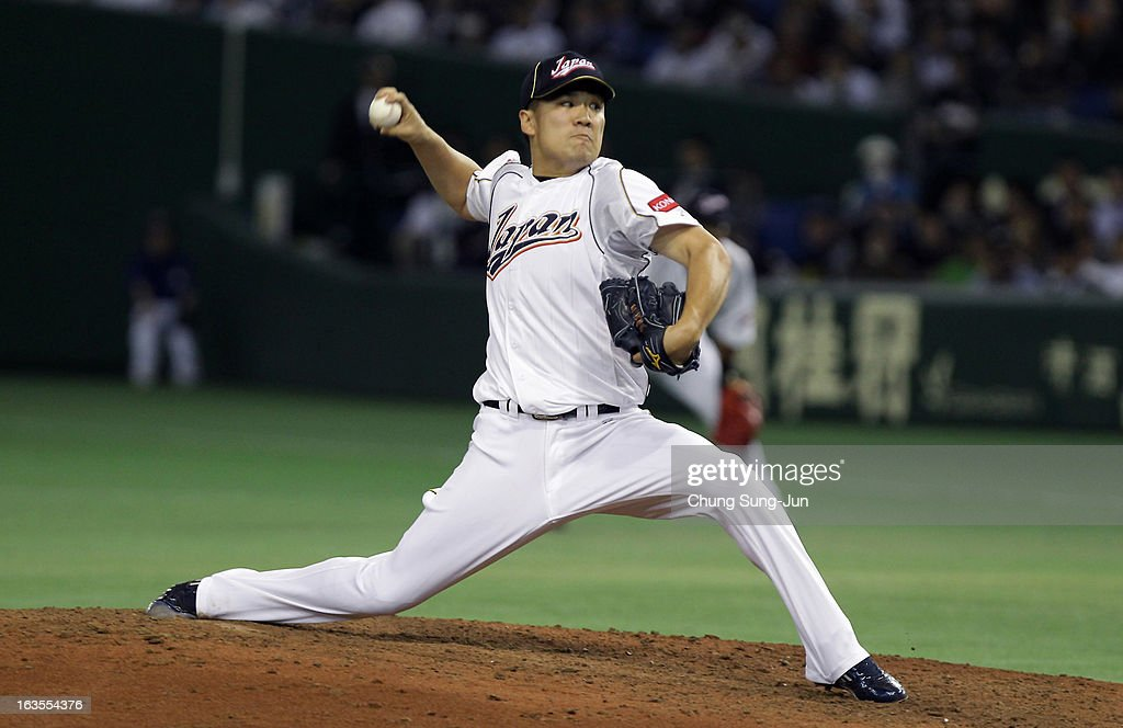 Pitcher <a gi-track='captionPersonalityLinkClicked' href=/galleries/search?phrase=Masahiro+Tanaka&family=editorial&specificpeople=5492836 ng-click='$event.stopPropagation()'>Masahiro Tanaka</a> # 17 of Japan pitches in the fifth inning during the World Baseball Classic Second Round Pool 1 game between Japan and the Netherlands at Tokyo Dome on March 12, 2013 in Tokyo, Japan.